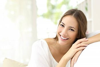 A woman smiling on a couch