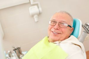 man has received dental implants in Portage